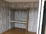 内装リフォームLDKの一部としながらも、間仕切り壁で独立した使い方もできる洋室
